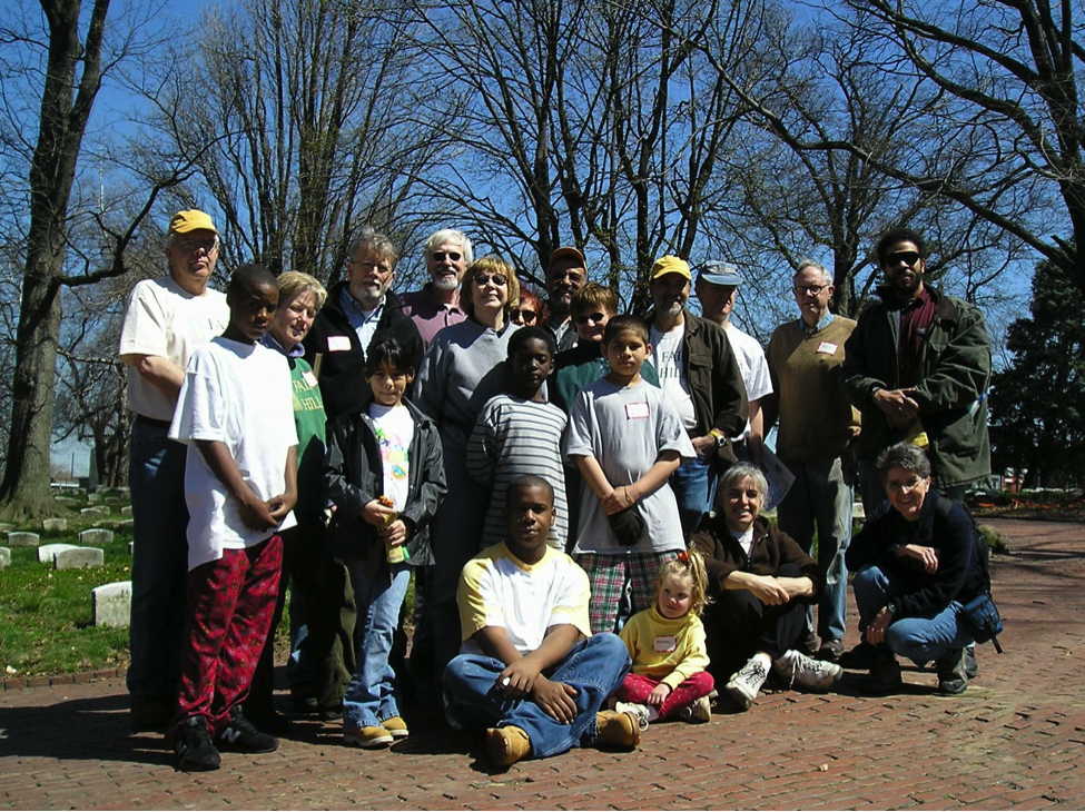 A group of early participants gathers for a photo